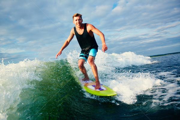 Doğa sporları erkek sörfçü binicilik dalgalar su Stok fotoğraf © pressmaster