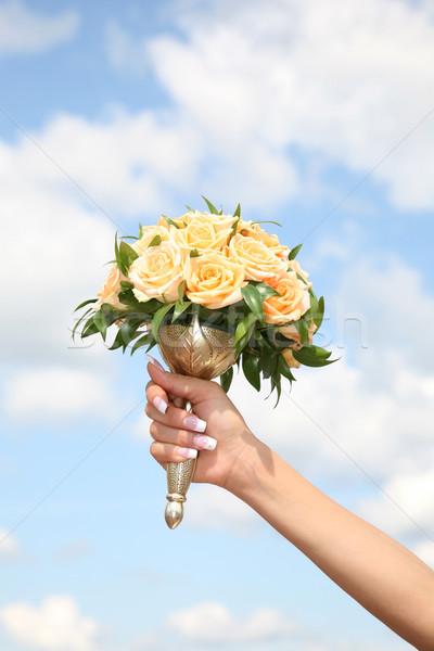 Menyasszonyi virágcsokor közelkép kéz tart citromsárga Stock fotó © pressmaster