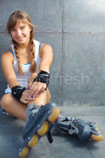Stock photo: Pretty rollerskater