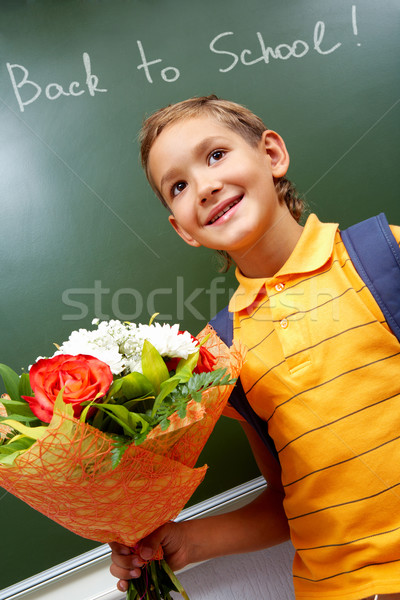 Boy with flowers Stock photo © pressmaster
