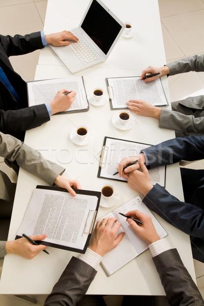 Yazılı çalışmak görüntü iş adamları eller yazı Stok fotoğraf © pressmaster
