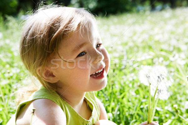 Child with flowers Stock photo © pressmaster