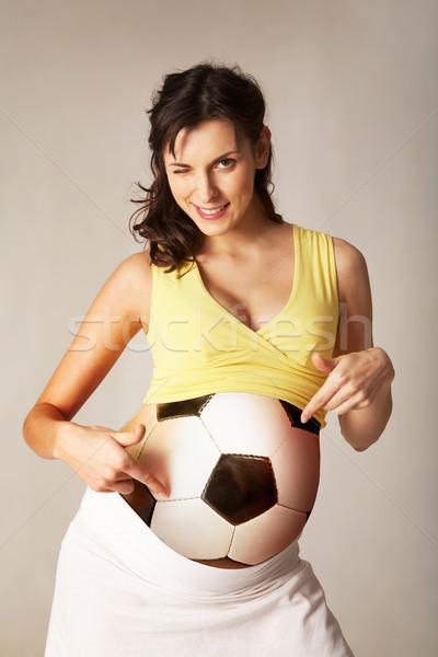 Indicação barriga foto bastante mulher grávida bola Foto stock © pressmaster