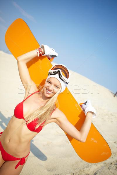 Bikini embarque sesión arena snowboard Foto stock © pressmaster