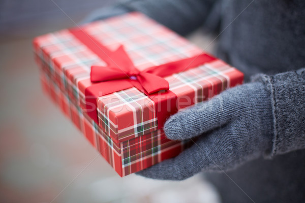 Giftbox in hands Stock photo © pressmaster