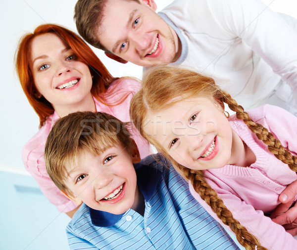 Családi portré boldog pár kettő gyerekek mosolyog Stock fotó © pressmaster
