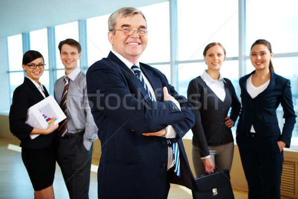 Imagem senior líder sorridente câmera Foto stock © pressmaster