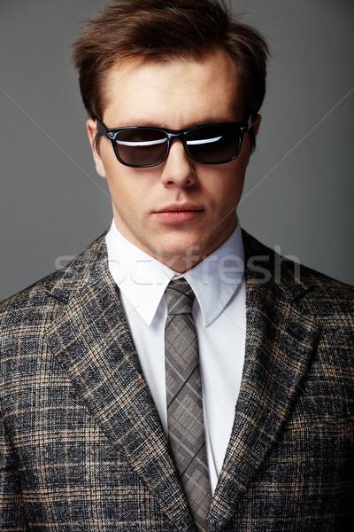 Elegancki człowiek obraz patrząc kamery twarz Zdjęcia stock © pressmaster