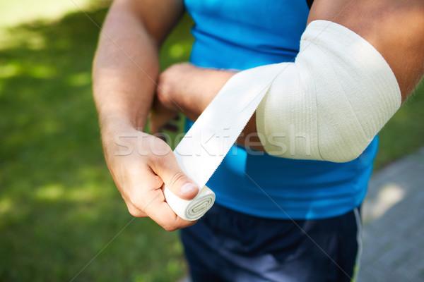 Bandaging arm Stock photo © pressmaster