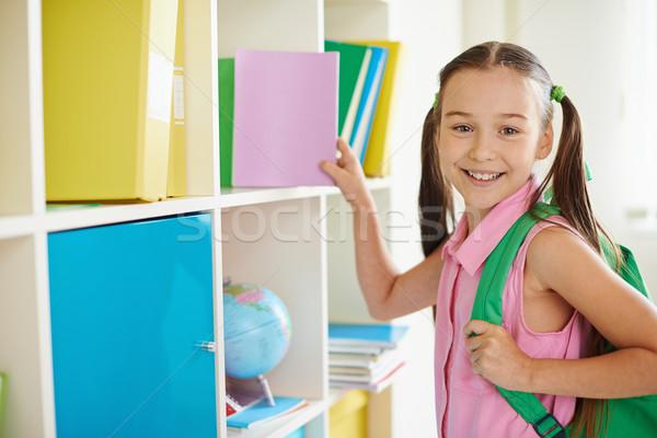 Girl taking book Stock photo © pressmaster