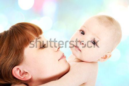 Maternal amor primer plano positivo mujer mirando Foto stock © pressmaster
