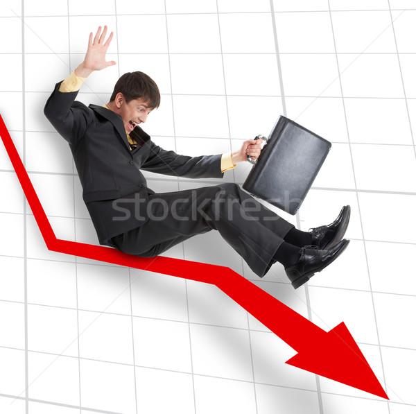 Hanyatlás üzletember mozog lefelé nyíl üzlet Stock fotó © pressmaster