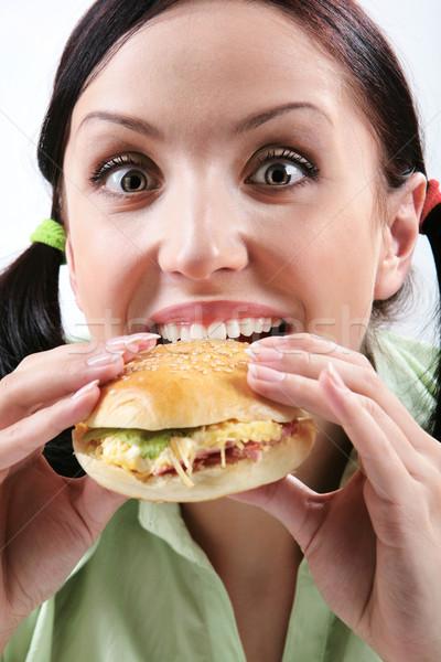 голод изображение голодный девушки еды гамбургер Сток-фото © pressmaster