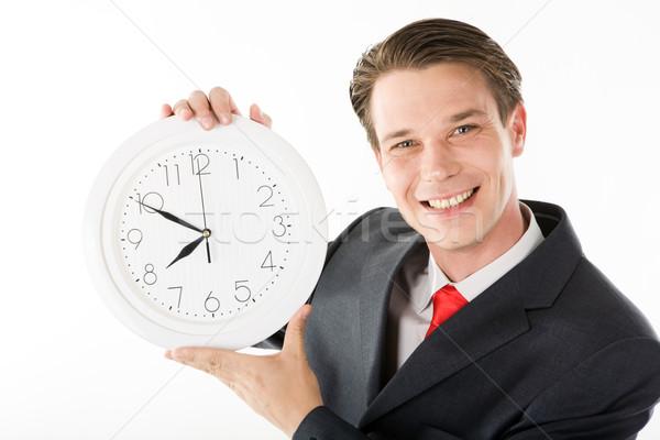 Szczęśliwy pracodawca Fotografia uśmiechnięty zegar ręce Zdjęcia stock © pressmaster