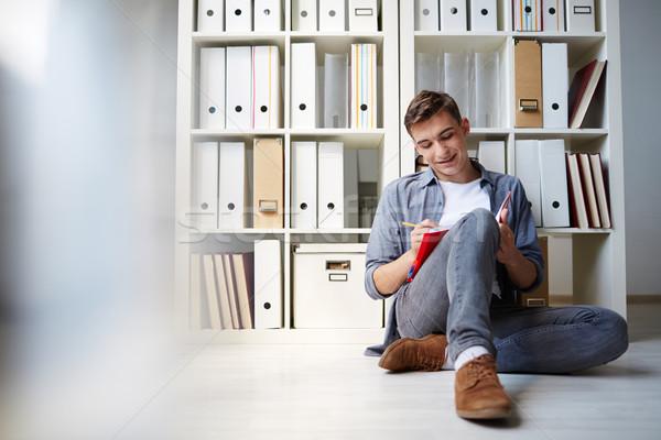 Otthon megbízás boldog fickó ül padló Stock fotó © pressmaster