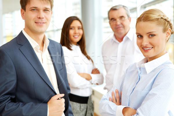 Foto stock: Equipo · de · negocios · retrato · gente · de · negocios · mirando · cámara · negocios
