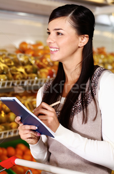 Shopper in supermarket Stock photo © pressmaster