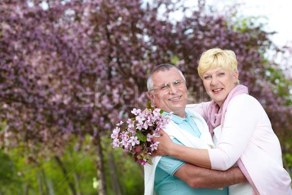 Szerelmi pár boldog érett átkarol virágzó Stock fotó © pressmaster