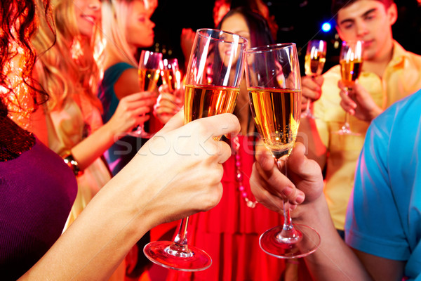 Clinking glasses with champagne Stock photo © pressmaster