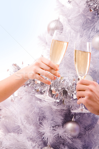 Happy new year champagne flûtes humaine mains Photo stock © pressmaster