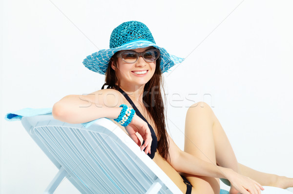 Smiling girl chaise lounge  Stock photo © pressmaster