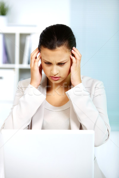Troubled businesswoman Stock photo © pressmaster