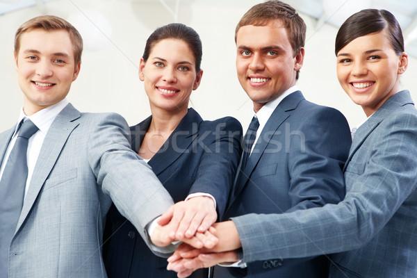 Zeile Geschäftsleute Hände Unterstützung Macht Stock foto © pressmaster