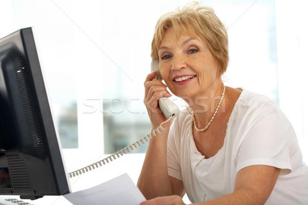 Falador feminino retrato senior chamada sorridente Foto stock © pressmaster