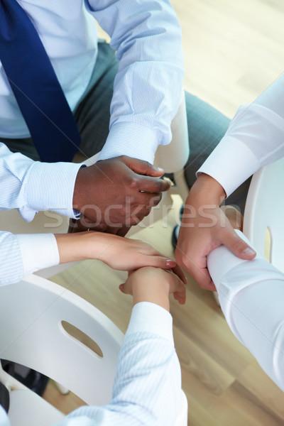 Stock fotó: Kör · partnerek · kezek · három · üzletemberek · ül