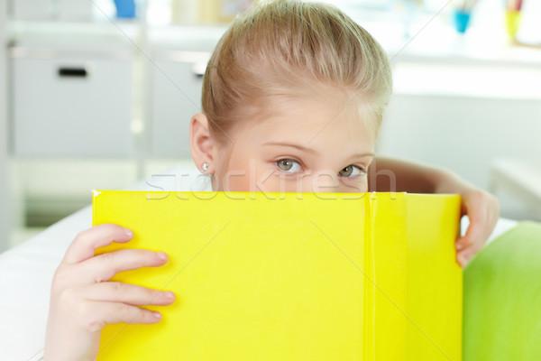 Peeking out of book Stock photo © pressmaster