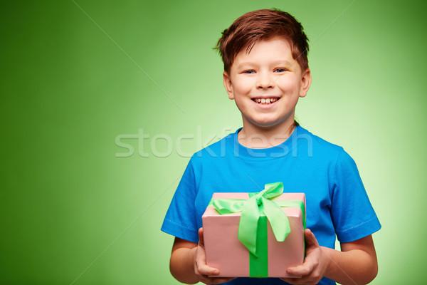 мальчика настоящее радостный глядя камеры изоляция Сток-фото © pressmaster