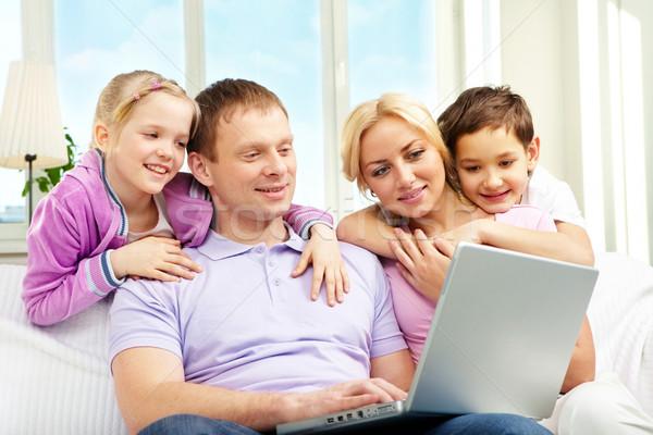 Family and laptop Stock photo © pressmaster