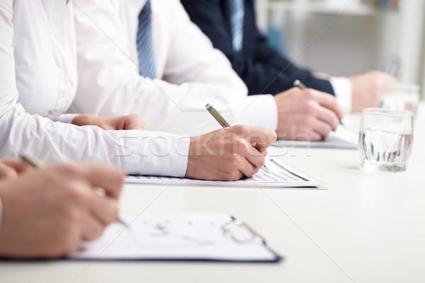 Seminário pessoas de negócios negócio papel mão Foto stock © pressmaster