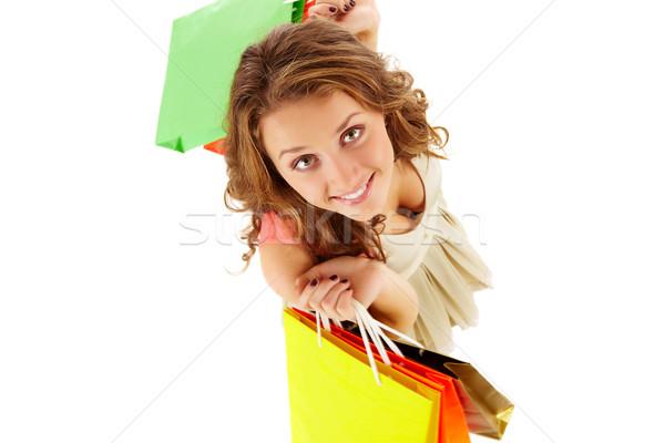 Consumidor acima ângulo menina olhando Foto stock © pressmaster
