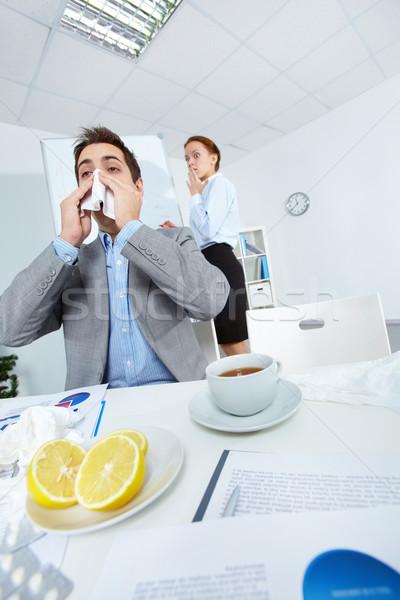 Sneezing in office Stock photo © pressmaster