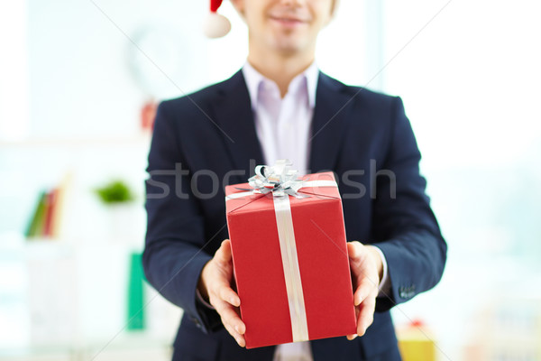 Giving xmas present Stock photo © pressmaster