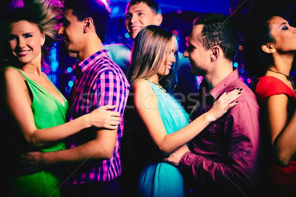 Attrakció boldog fiatal pér diszkó tánc barátok Stock fotó © pressmaster