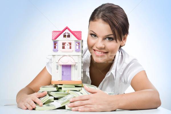 Megtakarított pénz portré gyönyörű nő megérint halom pénz Stock fotó © pressmaster