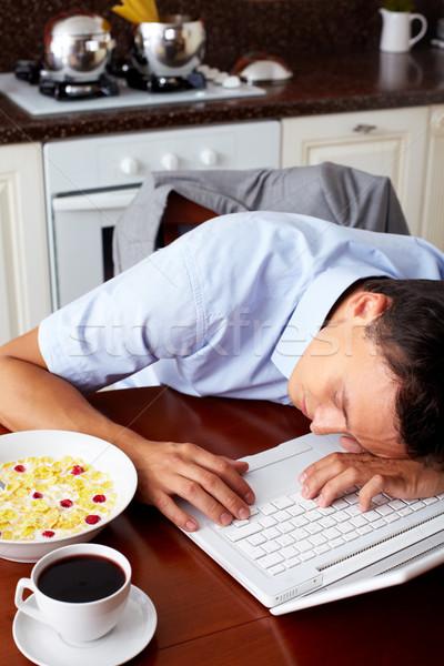 álmos férfi portré alszik laptop numerikus billentyűzet Stock fotó © pressmaster
