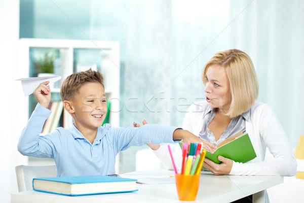 Portret niegrzeczny chłopca gry papieru Zdjęcia stock © pressmaster