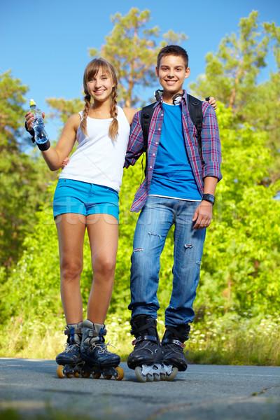 Stock photo: Couple on roller skates