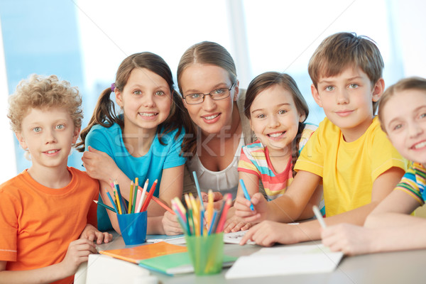 Classmates and teacher Stock photo © pressmaster