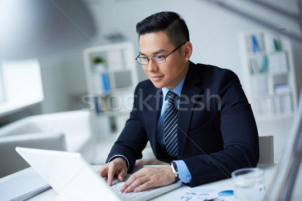 Stock photo: Businessman typing