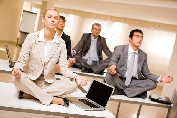 Meditating business partners Stock photo © pressmaster