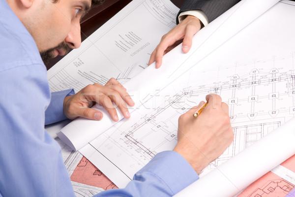 Occupés ingénieur au-dessus vue plan travail Photo stock © pressmaster
