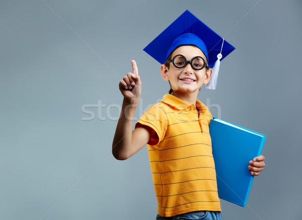 Inteligentes chico retrato libro mirando Foto stock © pressmaster