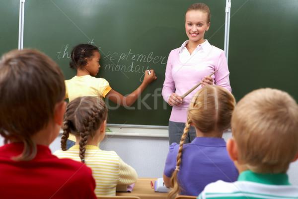 Lekcja widok z tyłu uczniowie posiedzenia patrząc nauczyciel Zdjęcia stock © pressmaster