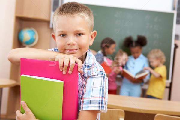 прилежный изображение Smart школьник глядя камеры Сток-фото © pressmaster