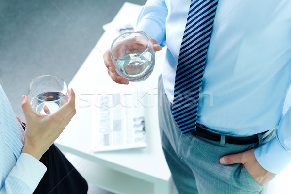 Stock photo: Holding glasses