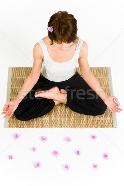 Pretty woman seduta piano yoga Foto d'archivio © pressmaster